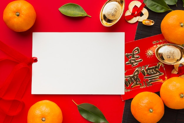 Flat lay new year chinese 2021 oranges and copy space paper