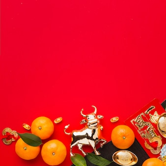 Flat lay new year chinese 2021 oranges and golden ox