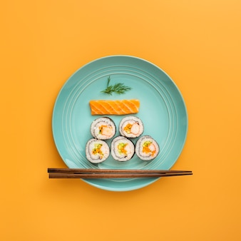 Flat lay nigiri and maki sushi  with chopsticks