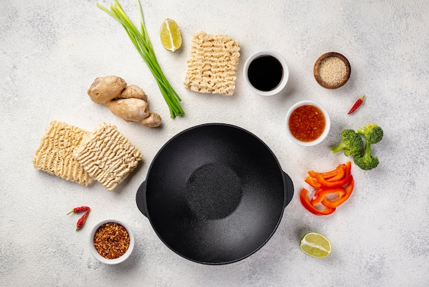Flat lay noodles and spices mix with plate