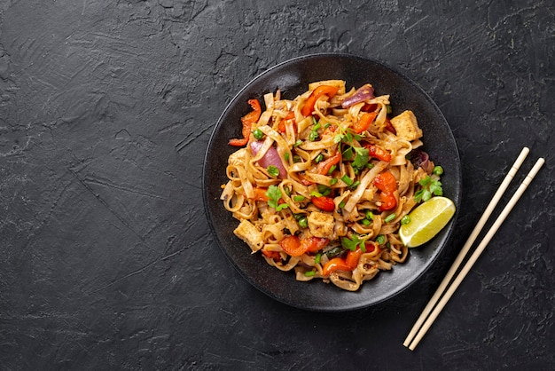 Flat lay noodles with vegetables and chicken with copy space