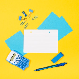 Flat lay of note mock-up with yellow background