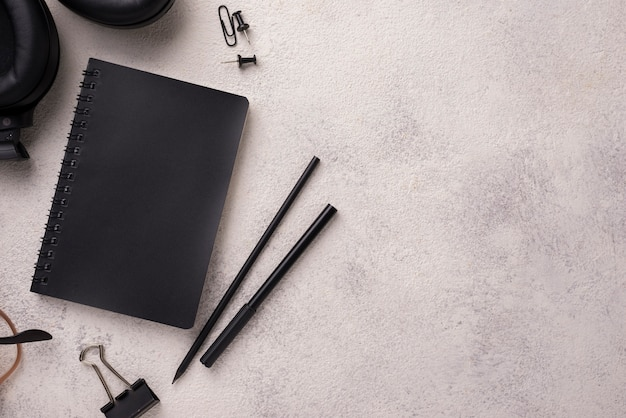 Flat lay of notebook on desk with copy space