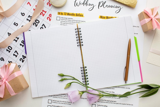 Flat lay notebook and wedding calendar