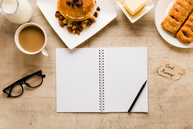 Flat lay notebook with pancakes