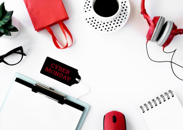 Flat lay of notebook with shopping bag and cyber monday tag