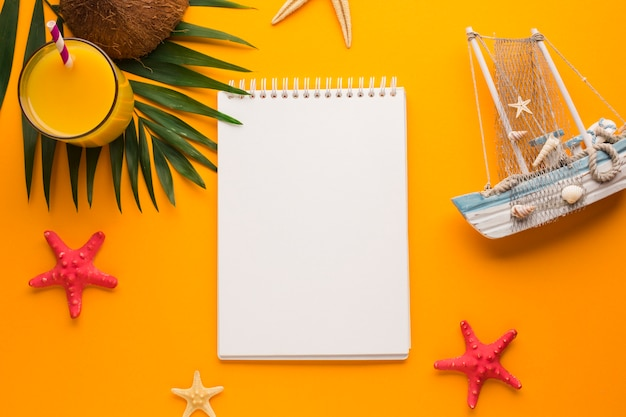 Flat lay notebook with vacation concept