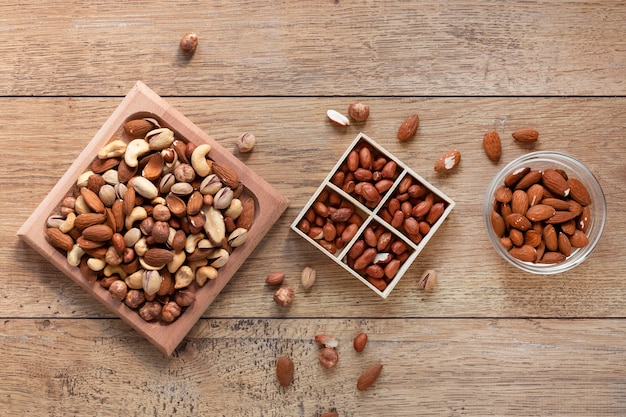 Flat lay of nuts arrangement on wooden table