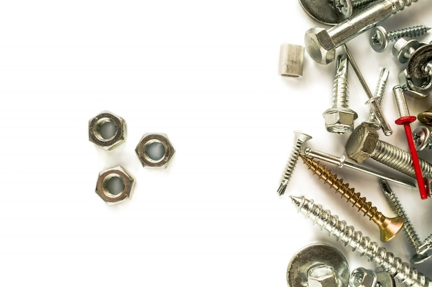 Flat lay of nuts isolated on white. self drilling screws. isolated fasteners.