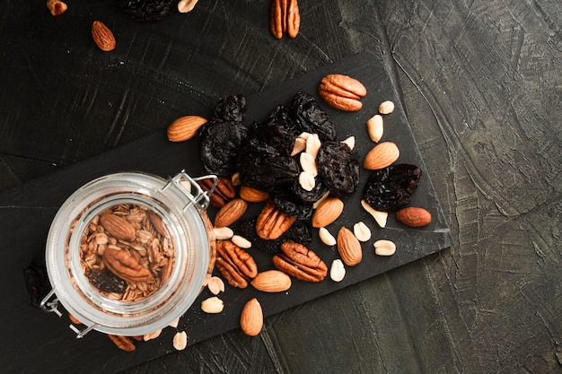 Flat lay oats jar with nuts mix and dates