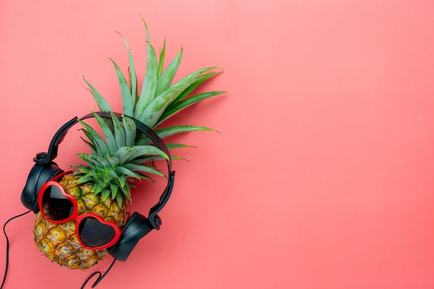 Flat lay object the pineapple listening radio by black headphone for sign of seasonal .