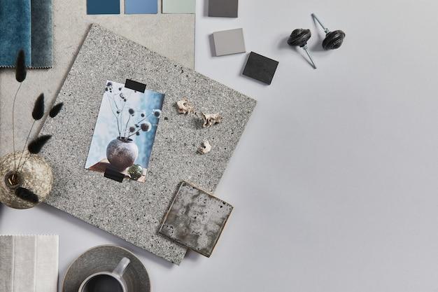 건물, 직물, 천연 재료 및 개인 액세서리 샘플이 포함된 창의적인 건축가 무드보드 구성의 평평한 평지. 상위 뷰, 회색 배경, 템플릿입니다.