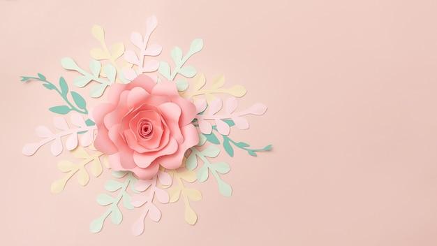 파스텔 핑크 배경에 종이 꽃의 평평한 위치. 여름 패션과 트렌디한 프레임