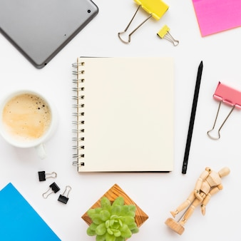 Flat lay of office desk with notebook