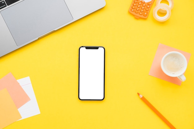 Flat lay of office desk with phone
