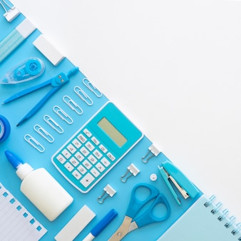 Flat lay of office stationery with calculator and copy space