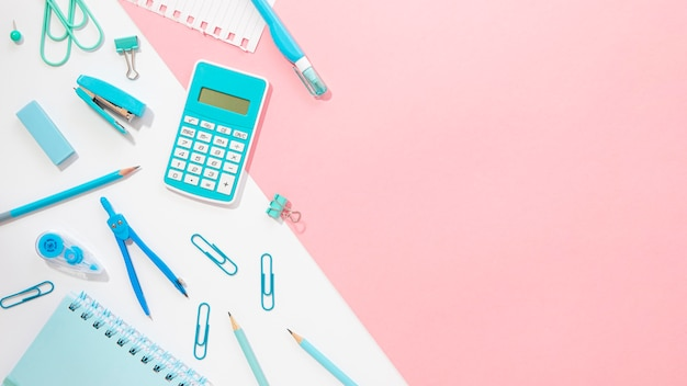 Flat lay of office stationery with compass and calculator