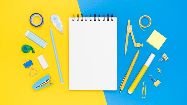 Flat lay of office stationery with eraser and stapler