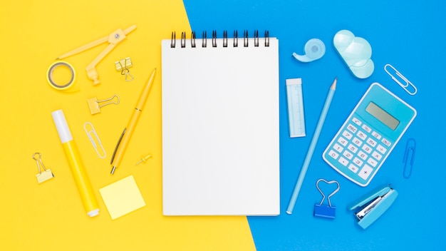 Flat lay of office stationery with notebook and stapler
