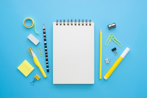 Flat lay of office stationery with notebook and sticky notes