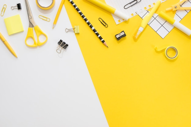 Flat lay of office stationery with paper clips and pencil