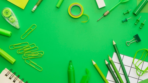 Flat lay of office stationery with paper clips and pencils