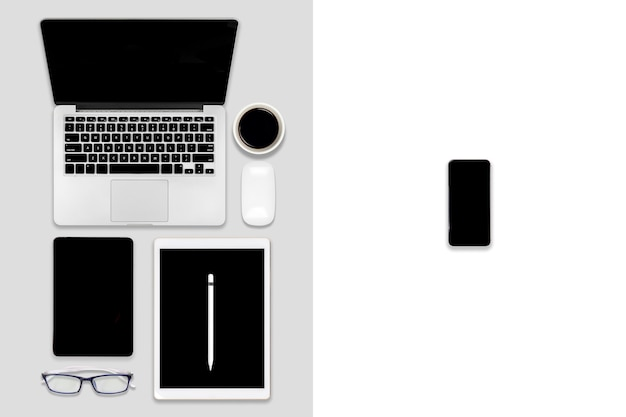 Flat lay of office table with laptop computer, digital tablet, mobile phone and accessories.