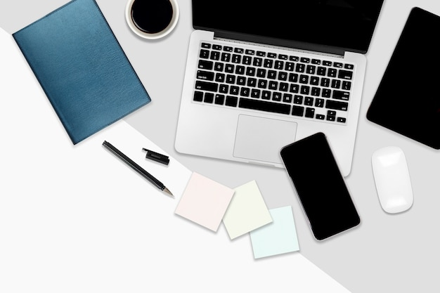 Flat lay office table with laptop computer, digital tablet, mobile phone and accessories.
