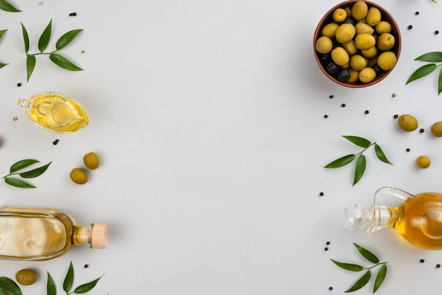 Flat lay olives, leaves and olive oil