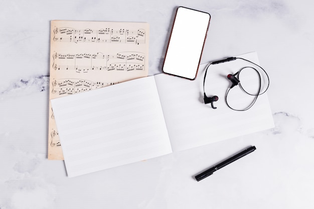 Flat lay of open book for music notes