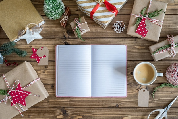 Flat lay of open notebook and christmas gifs