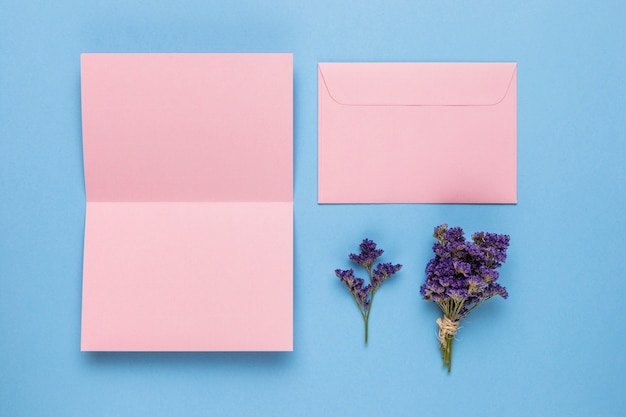 Flat lay opened pink wedding invitation