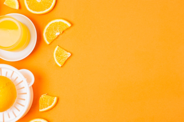 Flat lay orange juice on orange background with copy space