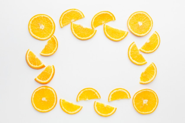 Flat lay of orange slices frame concept