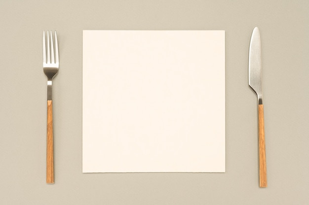 Flat lay overhead view blank recipe paper page, card and cutlery