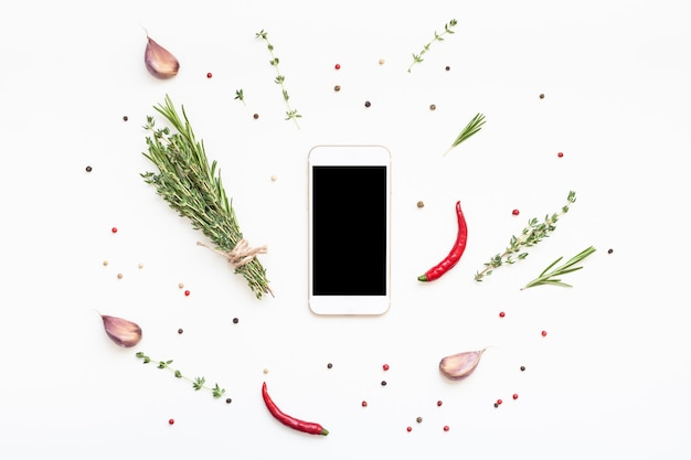 Flat lay overhead view smartphone mockup blank text space on white background greens herbs spices