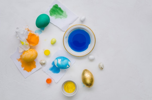 Flat lay of painted eggs with dye for easter