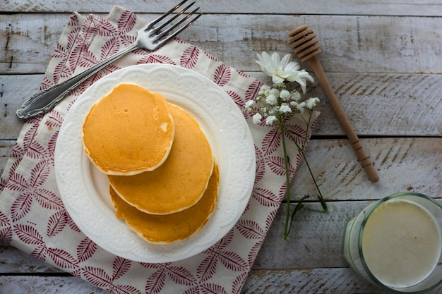 Flat lay pancakes on plate