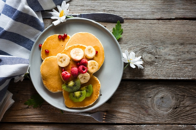 Flat lay pancakes with mix of fruits