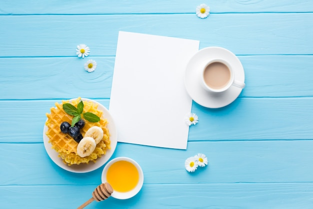 Flat lay paper card mockup on breakfast table
