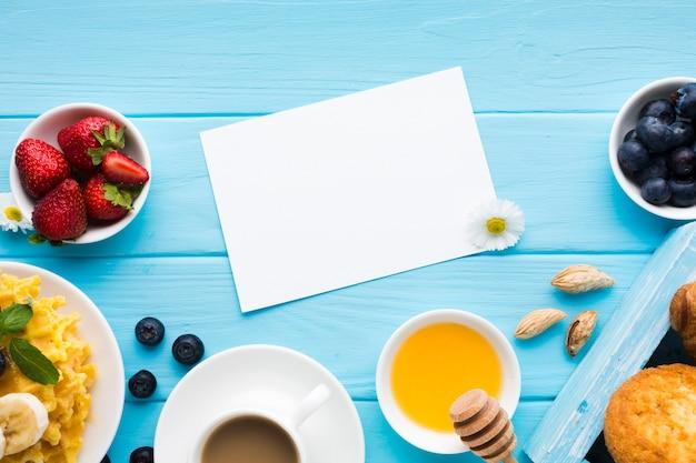 Flat lay paper card mockup on breakfast table