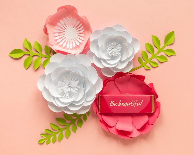 Flat lay of paper flower arrangement for women's day