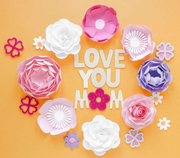 Flat lay paper flowers on orange background
