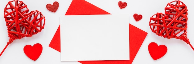 Flat lay of paper and hearts for valentines day
