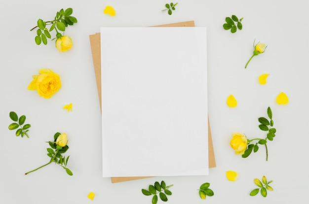 Flat lay paper mockup with floral elements