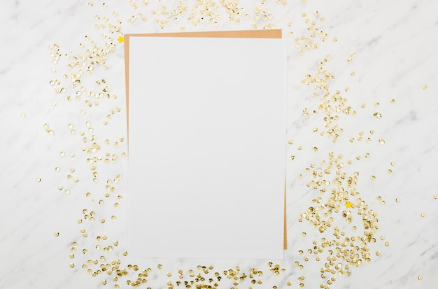 Flat lay paper mockup with golden confetti