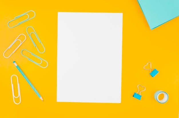 Flat lay paper mockup on workspace