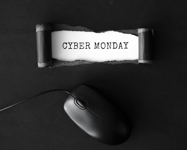 Flat lay of paper ripped for cyber monday with mouse