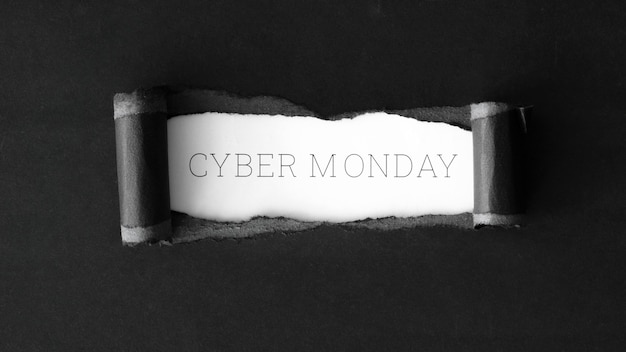 Flat lay of paper ripped for cyber monday
