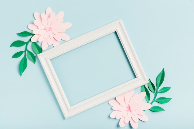 Flat lay of paper spring flowers with frame